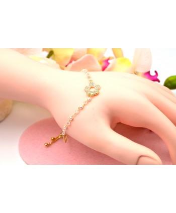 Bransoletka stal złocona z kwiatuszkiem i perełkami