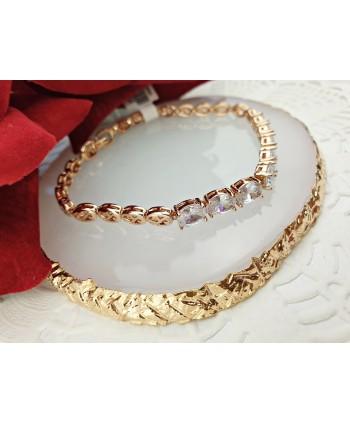 Bransoletka stal złota z kryształkami na środku