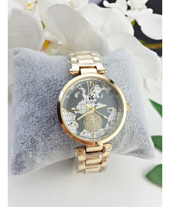 Zegarek damski na złotej bransolecie z mapą świata