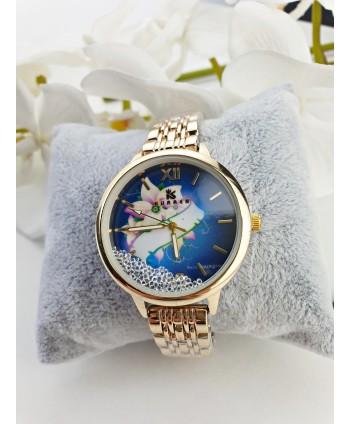 Zegarek damski na złotej bransolecie z przesypującymi się kryształkami