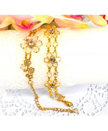 Bransoletka przezroczyste kryształki w złotej oprawie w kwiatowych wzorach