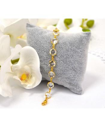 Bransoletka przezroczyste kryształki w złotej oprawie